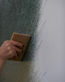 Meticulous work: Stamping the painting. Photo Benjamin McMahon